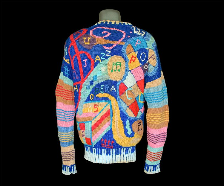 Pullover  enriched with musical instruments and notes..